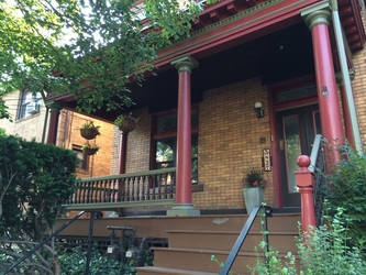 Pittsburgh furnished house for rent. Brick exterior with front porch.